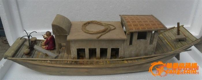 一个纯手工制成的木质的渔船