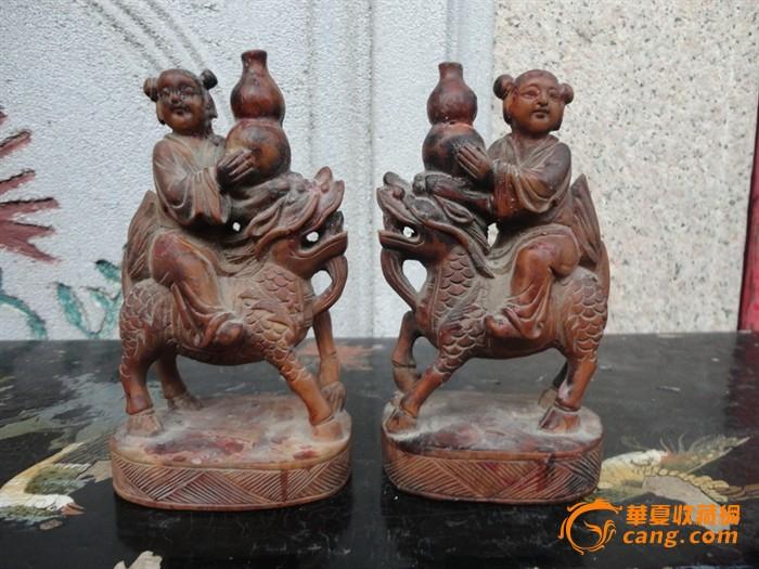 潮州木刻:民国黄杨木雕童子骑麒麟抱葫芦烛台一对