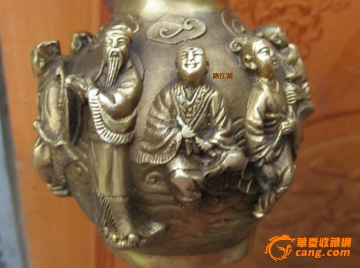 一个雕刻八仙的铜葫芦