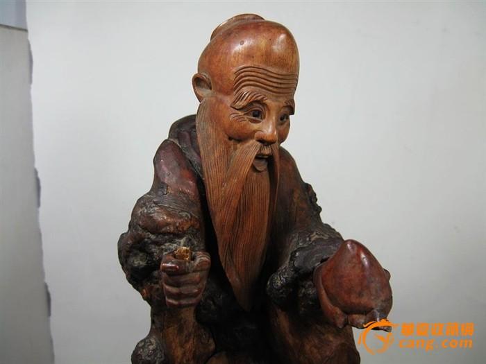 清代黄杨木东方溯偷桃雕像图片