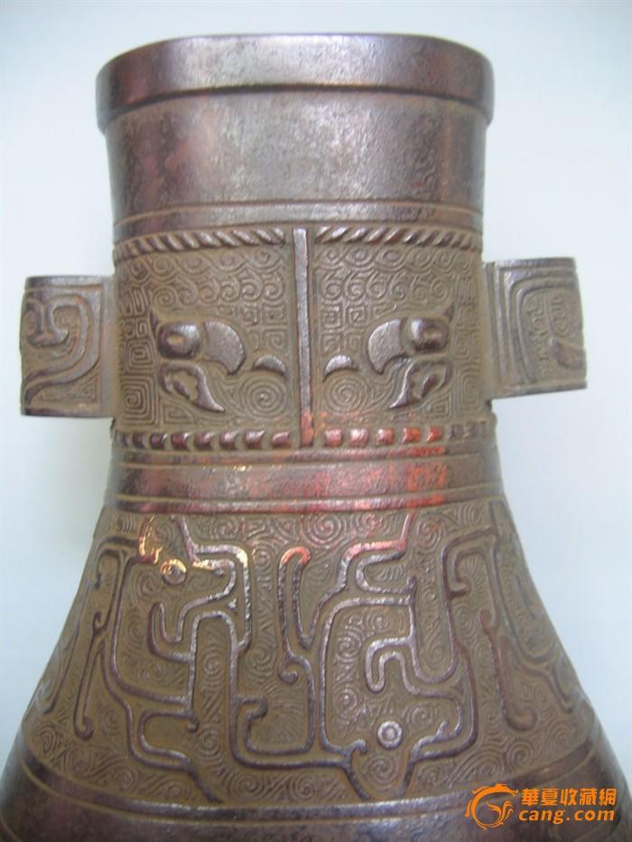 地摊 铜器 清供 > 清_青铜纹饰贯耳扁瓶_25cm   显示上一幅图片 显示
